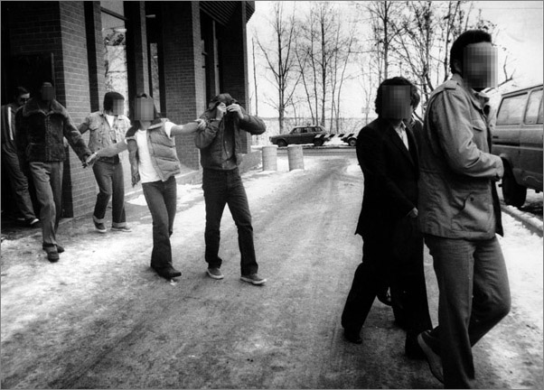 Photos: Robert Hansen hides his face from reporters